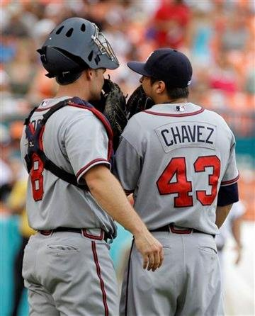 Atlanta Braves catcher David Ross (8) talks with relief pitcher Jesse Chavez (43) in the eleventh inning during a baseball game against the Florida Marlins in Miami, Sunday, July 25, 2010. The Marlins won 5-4. (AP Photo/Lynne Sladky) By Lynne Sladky