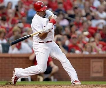 St. Louis Cardinals' Albert Pujols connects for a solo home run in the fifth inning of a baseball game against the Pittsburgh Pirates, Saturday, July 31, 2010, in St. Louis.(AP Photo/Tom Gannam) By Tom Gannam