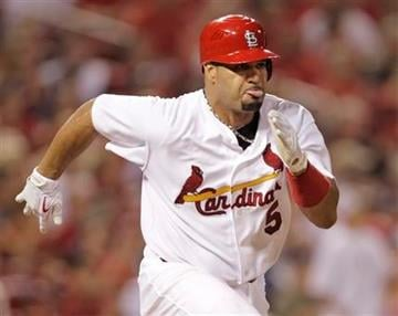 St. Louis Cardinals' Albert Pujols runs to first for a single in the seventh inning of a baseball game against the Pittsburgh Pirates, Saturday, July 31, 2010 in St. Louis. (AP Photo/Tom Gannam) By Tom Gannam