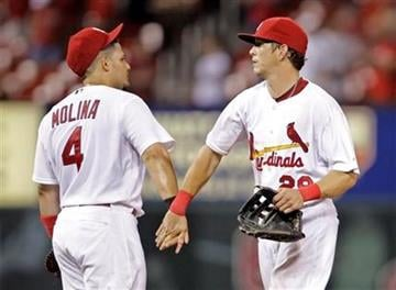 St. Louis Cardinals' Yadier Molina (4) celebrates with teammate Colby Rasmus after defeating the Pittsburgh Pirates in a baseball game, Saturday, July 31, 2010, in St. Louis. The Cardinals won 11-1. (AP Photo/Tom Gannam) By Tom Gannam