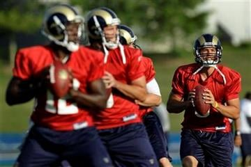 St. Louis Rams quarterback Sam Bradford, right, throws with fellow quarterbacks, from left to right, Thaddeus Lewis, Keith Null and A.J. Feeley during NFL football training camp Sunday, Aug. 1, 2010, in St. Louis. (AP Photo/Jeff Roberson) By Jeff Roberson