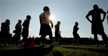 Members of the St. Louis Rams take part in an evening practice as the sun hangs low in the sky during NFL football training camp Sunday, Aug. 1, 2010, in St. Louis. (AP Photo/Jeff Roberson) By Jeff Roberson