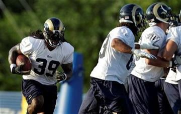 St. Louis Rams running back Steven Jackson (39) runs with the ball during NFL football training camp at the team's training facility Sunday, Aug. 1, 2010, in St. Louis. (AP Photo/Jeff Roberson) By Jeff Roberson
