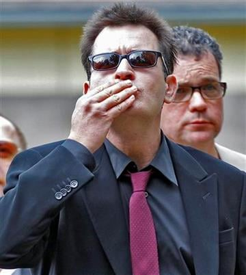 Charlie Sheen blows a kiss  as he arrives at the Pitkin County Courthouse in Aspen, Colo., on Monday, Aug. 2, 2010, for a hearing in his domestic abuse case. (AP Photo/Ed Andrieski By Ed Andrieski