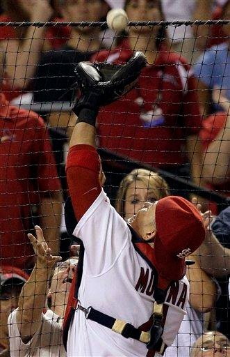 St. Louis Cardinals catcher Yadier Molina catches a foul ball hit by Houston Astros' Hunter Pence at the backstop for an out during the eighth inning of a baseball game Monday, Aug. 2, 2010, in St. Louis. (AP Photo/Jeff Roberson) By Jeff Roberson