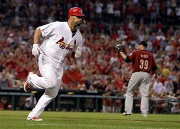 St. Louis Cardinals' Albert Pujols, left, rounds the bases on a solo home run off Houston Astros starting pitcher Brett Myers, right, during the fourth inning of a baseball game Monday, Aug. 2, 2010, in St. Louis. (AP Photo/Jeff Roberson) By Jeff Roberson