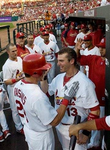 St. Louis Cardinals' Colby Rasmus, left, celebrates with Brendan Ryan after hitting a solo home run during the first inning of a baseball game against the Houston Astros on Tuesday, Aug. 3, 2010, in St. Louis. (AP Photo/Jeff Curry) By Jeff Curry
