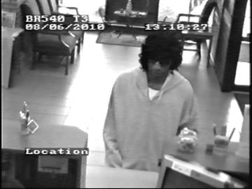Police are searching for a suspect in the robbery of the UMB Bank branch at 1201 Regency Parkway in St. Charles.