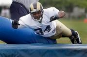 St. Louis Rams running back Kenneth Darby takes part in drills during NFL football training camp at the team's training facility Thursday, Aug. 5, 2010, in St. Louis. (AP Photo/Jeff Roberson) By Jeff Roberson
