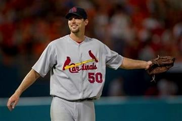 St. Louis Cardinals starting pitcher Adam Wainwright watches the final Florida Marlins out during the ninth inning of baseball game action in Miami, Friday, Aug. 6, 2010. The Cardinals won 7-0. (AP Photo/J Pat Carter) By J Pat Carter