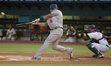 Florida Marlins catcher Brett Hayes, right, watches St. Louis Cardinals batter Albert Pujois hit a first-inning three-home run during baseball action in Miami, Friday, Aug. 6, 2010. (AP Photo/J Pat Carter) By J Pat Carter