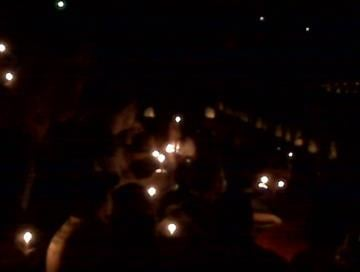 People lit candles at Daniel Schatz's memorial service to form the number he wore as a football player at Sullivan High School. By KMOV Web Producer