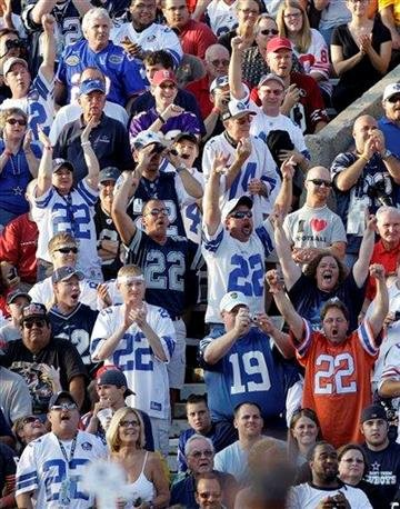 Fans cheer as former Dallas Cowboys great Emmitt Smith is introduced at the start of the enshrinement ceremony at the Pro Football Hall of Fame in Canton, Ohio Saturday, Aug. 7, 2010. (AP Photo/Mark Duncan) By Mark Duncan