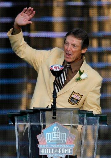 Former Detroit Lions player Dick LeBeau waves after his enshrinement in the Pro Football Hall of Fame in Canton, Ohio, Saturday, Aug. 7, 2010. (AP Photo/Ron Schwane) By Ron Schwane