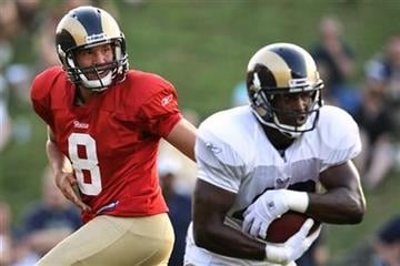 St. Louis Rams'  Sam Bradford hands off to St. Louis Rams' Jamie McCoy during an NFL training camp scrimmage on Saturday, Aug. 7, 2010, in St. Charles, Mo. (AP Photo/St. Louis Post-Dispatch, Erik M. Lunsford) By Erik M. Lunsford