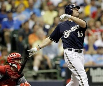 Milwaukee Brewers' Jim Edmonds hits a home run during the eighth inning of a baseball game against the Cincinnati Reds Monday, July 26, 2010, in Milwaukee. (AP Photo/Morry Gash) By Morry Gash