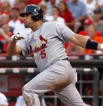 St. Louis Cardinals' Albert Pujols hits an RBI single off Cincinnati Reds pitcher Carlos Fisher in the fourth inning of a baseball game Monday, August 9, 2010 in Cincinnati. The Cardinals won 7-3. (AP Photo/David Kohl) By David Kohl