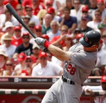 St. Louis Cardinals' Colby Rasmus swings as he hits a grand slam off Cincinnati Reds pitcher Bronson Arroyo in the fifth inning of a baseball game Wednesday, August 11, 2010 in Cincinnati. (AP Photo/David Kohl) By David Kohl