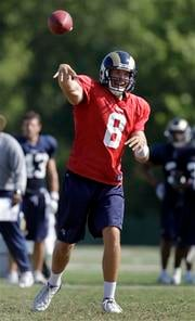 St. Louis Rams quarterback Sam Bradford throws during NFL football training camp at the team's training facility Wednesday, Aug. 11, 2010, in St. Louis. (AP Photo/Jeff Roberson) By Jeff Roberson