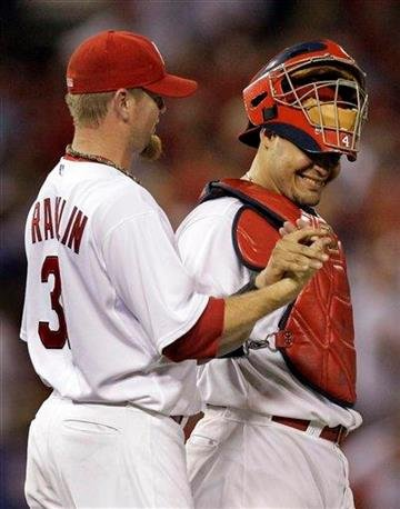 St. Louis Cardinals catcher Yadier Molina, right, and relief pitcher Ryan Franklin celebrate their 6-3 victory over the Chicago Cubs during a baseball game Friday, Aug. 13, 2010, in St. Louis. (AP Photo/Jeff Roberson) By Jeff Roberson
