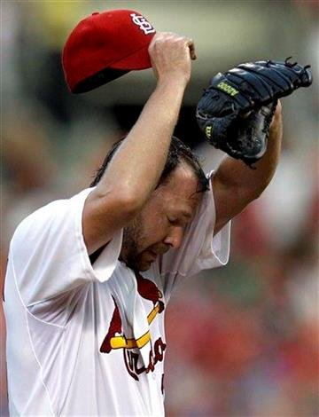 St. Louis Cardinals starting pitcher Jake Westbrook pauses on the mound while working during the first inning of a baseball game against the Chicago Cubs Friday, Aug. 13, 2010, in St. Louis. (AP Photo/Jeff Roberson) By Jeff Roberson