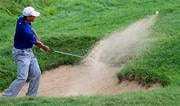 Tiger Woods hits out of a bunker on the ninth hole during the third round of the PGA Championship golf tournament Saturday, Aug. 14, 2010, at Whistling Straits in Haven, Wis. (AP Photo/Jeffrey Phelps) By Jeffrey Phelps