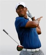 Tiger Woods drops his club after hitting his drive in the rough on the 11th hole during the third round of the PGA Championship golf tournament Saturday, Aug. 14, 2010, at Whistling Straits in Haven, Wis. (AP Photo/Jeffrey Phelps) By Jeffrey Phelps