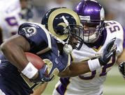 St. Louis Rams running back Chris Ogbonnaya, (22), runs through Minnesota Vikings linebacker Chad Greenway (52), during the first quarter of a preseason NFL football game Saturday, Aug. 14, 2010, in St Louis. (AP Photo/Seth Perlman) By Seth Perlman