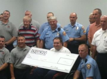 Rock hill police officer Matt Crosby receives a check for more than $9,000 thousand dollars from Brentwood police and fire fighters.  Crosby was shot while answering call on domestic dispute in April.
