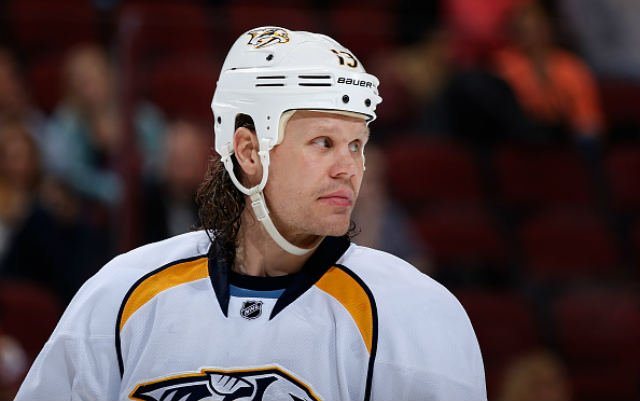 GLENDALE, AZ - DECEMBER 11: Olli Jokinen #13 of the Nashville Predators during the NHL game against the Arizona Coyotes at Gila River Arena on December 11, 2014 in Glendale, Arizona. The Predators defeated the Coyotes 5-1. (Photo by Christian Petersen/Get