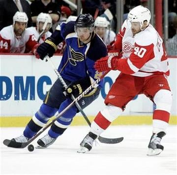 Detroit Red Wings' Henrik Zetterberg (40) and St. Louis Blues' Patrik Berglund, left, both of Sweden, battle for the puck during the first period of an NHL hockey game on Wednesday, March 30, 2011, in Detroit. (AP Photo/Duane Burleson) By Duane Burleson