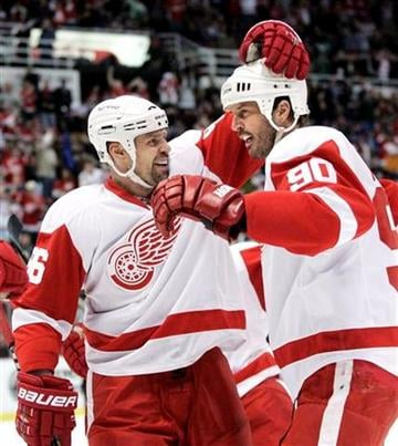 Detroit Red Wings' Mike Modano (90) celebrates his goal with Tomas Holmstrom, of Sweden, during the first period of an NHL hockey game against the St. Louis Blues, Wednesday, March 30, 2011, in Detroit. (AP Photo/Duane Burleson) By Duane Burleson