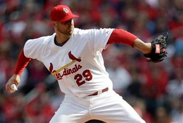 St. Louis Cardinals starting pitcher Chris Carpenter throws during the second inning of a baseball game against the San Diego Padres Thursday, March 31, 2011, in St. Louis. (AP Photo/Jeff Roberson) By Jeff Roberson