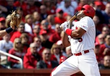 St. Louis Cardinals' Albert Pujols, right, is brushed back by an inside pitch as San Diego Padres catcher Nick Hundley catches the ball during the first inning of a baseball game Thursday, March 31, 2011, in St. Louis. (AP Photo/Tom Gannam) By Tom Gannam
