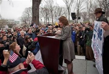"Rep. Michele Bachmann, R-Minn. addresses the Tea Party ""Continuing Revolution Rally"" on Capitol Hill in Washington, Thursday, March 31, 2011.  (AP Photo/Evan Vucci) By Evan Vucci"