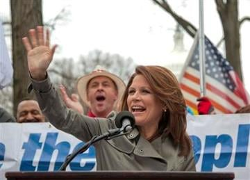 "Rep. Michele Bachmann, R-Minn. gestures while addressing a Tea Party ""Continuing Revolution Rally"" on Capitol Hill in Washington, Thursday, March 31, 2011.  (AP Photo/Evan Vucci) By Evan Vucci"