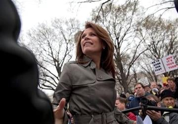 "Rep. Michele Bachmann, R-Minn. shakes hands with supporters during a Tea Party ""Continuing Revolution Rally"" on Capitol Hill in Washington, Thursday, March 31, 2011.  (AP Photo/Evan Vucci) By Evan Vucci"