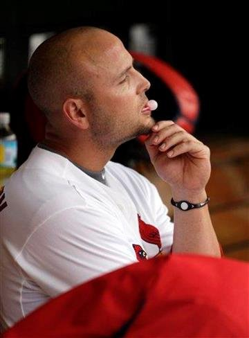 St. Louis Cardinals' Matt Holliday sits on the bench after being picked off at second base during the sixth inning of a baseball game against the San Diego Padres on opening day Thursday, March 31, 2011, in St. Louis. (AP Photo/Tom Gannam) By Tom Gannam