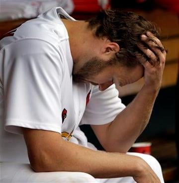 St. Louis Cardinals starting pitcher Jake Westbrook sits in the dugout after being pulled out of a baseball game against the San Diego Padres during the fifth inning on Saturday, April 2, 2011, in St. Louis. (AP Photo/Jeff Roberson) By Jeff Roberson