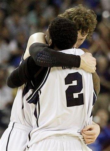 Butler's Matt Howard and Shawn Vanzant (2) embrace after their team beat Virginia Commonwealth 70-62 at a men's NCAA Final Four semifinal college basketball game Saturday, March 2, 2011, in Houston. (AP Photo/Eric Gay) By Eric Gay
