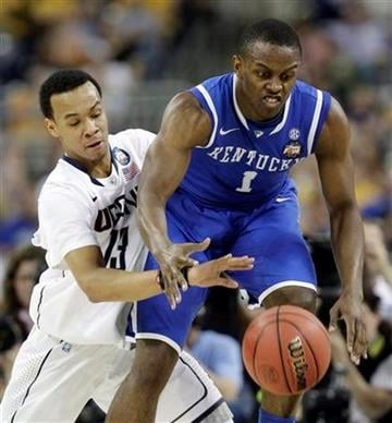 Kentucky's Darius Miller is defended by Connecticut's Shabazz Napier during the first half of a men's NCAA Final Four semifinal college basketball game Saturday, April 2, 2011, in Houston. (AP Photo/David J. Phillip) By David J. Phillip
