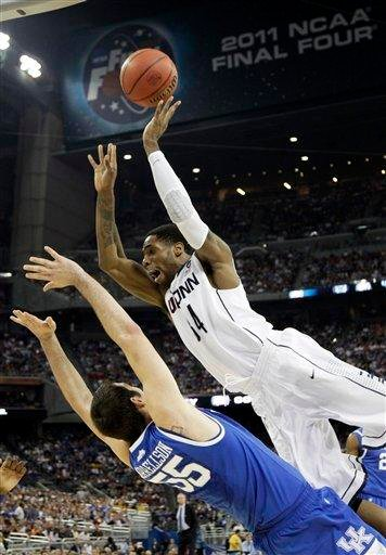 Connecticut's Alex Oriakhi loses the ball as Kentucky's Josh Harrellson defends during the first half of a men's NCAA Final Four semifinal college basketball game Saturday, April 2, 2011, in Houston. (AP Photo/David J. Phillip) By David J. Phillip