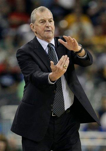 Connecticut head coach Jim Calhoun calls a timeout during the first half of a men's NCAA Final Four semifinal college basketball game against Kentucky Saturday, April 2, 2011, in Houston. (AP Photo/David J. Phillip) By David J. Phillip