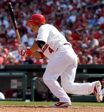 St. Louis Cardinals' Yadier Molina watches his RBI single during the fifth inning of a baseball game against the San Diego Padres on Sunday, April 3, 2011, in St. Louis. The Cardinals won 2-0. (AP Photo/Jeff Roberson) By Jeff Roberson