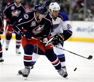 Columbus Blue Jackets' Sami Lepisto (4), of Finland, and St Louis Blues' B.J. Crombeen, right, go after a loose puck during the first period of an NHL hockey game Sunday, April 3, 2011, in Columbus, Ohio. (AP Photo/Terry Gilliam) By Terry Gilliam