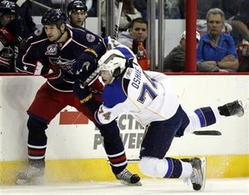 St Louis Blues' T.J. Oshie (74) collides with Columbus Blue Jackets' Fedor Tyutin during the first period of an NHL hockey game Sunday, April 3, 2011, in Columbus, Ohio. Blues won 6-1. (AP Photo/Terry Gilliam) By Terry Gilliam