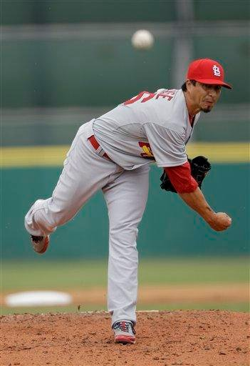 St. Louis Cardinals pitcher Kyle Lohse throws during the first inning of a spring training baseball game against the Houston Astros, Friday, March 4, 2011, in Kissimmee, Fla. (AP Photo/David J. Phillip) By David J. Phillip