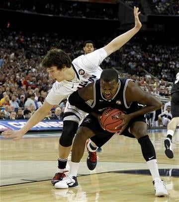 Butler's Shelvin Mack looks to shoot as Connecticut's Tyler Olander defends during the first half of the men's NCAA Final Four college basketball championship game Monday, April 4, 2011, in Houston. (AP Photo/David J. Phillip) By David J. Phillip