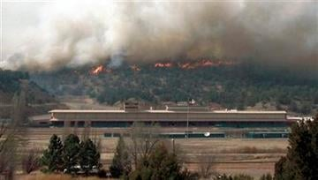 A wildfire rages behind the Ruidoso Downs Racetrack and Casino in Ruidoso Downs, N.M., Sunday, April 3, 2011. (AP Photo/Ruidoso News, Harold Oakes) By Harold Oakes