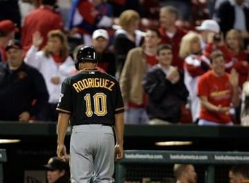 Pittsburgh Pirates' Josh Rodriguez (10) heads back to the dugout as St. Louis Cardinals fans cheer after the final out of a baseball game Tuesday, April 5, 2011, in St. Louis. The Cardinals beat the Pirates 3-2. (AP Photo/Tom Gannam) By Tom Gannam